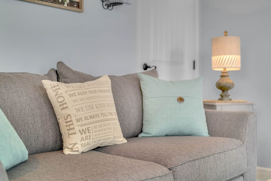 closeup view of throw pillows in living area of clermont cabanas in clermont florida