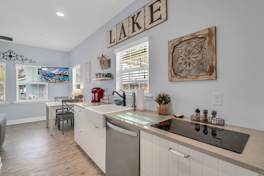 Lake sign over sink in full kitchen area of Clermont Cabanas