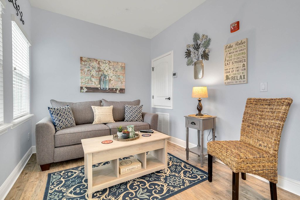 Living area in Clermont Cabanas with couch, coffee table and chair in azul unit